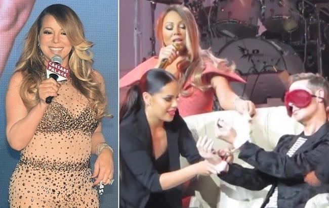 Photo of Mariah Carey muito atrevida algema fã em palco